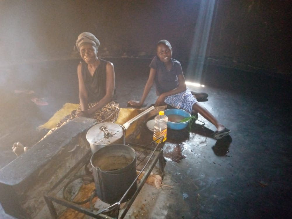 Pupil and her Grandmother in their home cooking